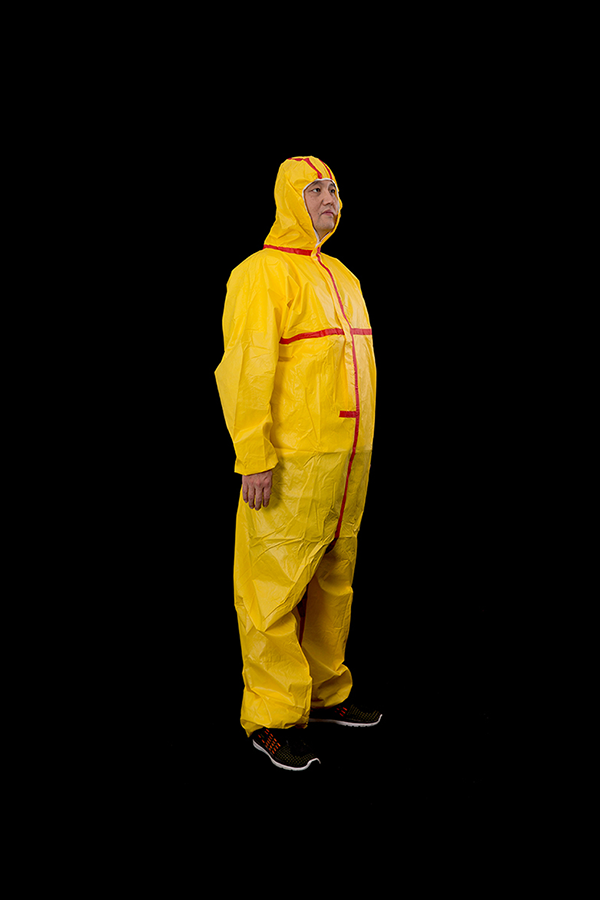 Yellow microporous coverall with red tape