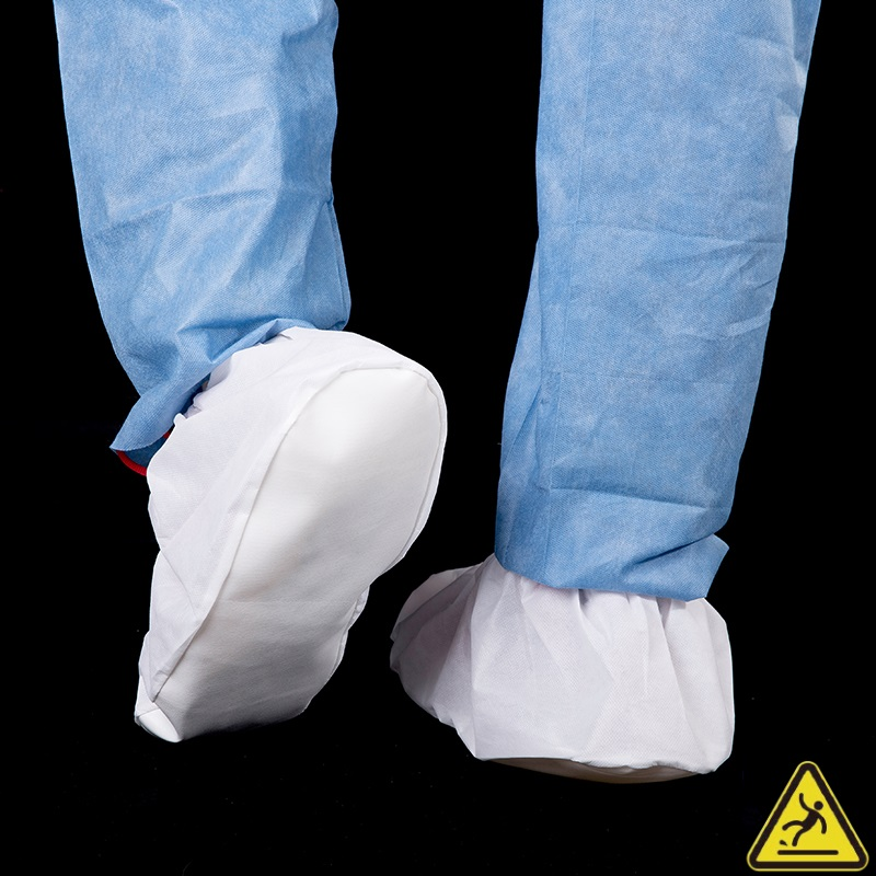 PE coated overshoes with PVC sole